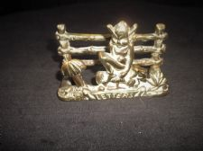 GENUINE VINTAGE SMALL BRASS LETTER RACK CAST LUCKY PIXIE ON TOADSTOOL BY FENCE